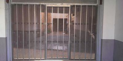Puertas Automáticas J.C puerta batiente microperforada